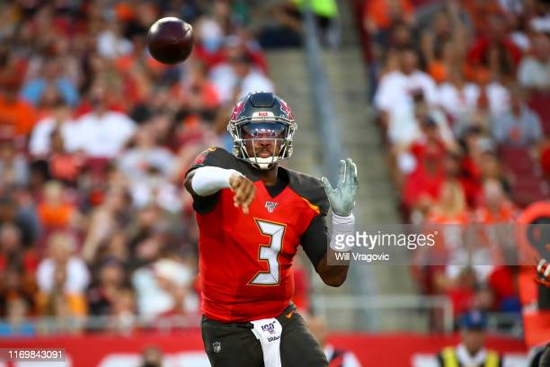 Jameis Winston of the Tampa Bay Buccaneers completes the pass to Chris Godwin in the first quarter of the preseason game against the Cleveland Browns...