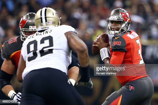 Jameis Winston of the Tampa Bay Buccaneers drops back to pass during the first quarter of a game against the New Orleans Saints at the MercedesBenz...