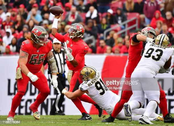 Jameis Winston of the Tampa Bay Buccaneers gets pressure from Trey Hendrickson of the New Orleans Saints during the fourth quarter of a football game...