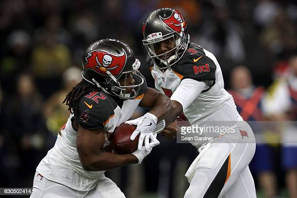 Jameis Winston of the Tampa Bay Buccaneers hands off to Jacquizz Rodgers of the Tampa Bay Buccaneers at the MercedesBenz Superdome on December 24...