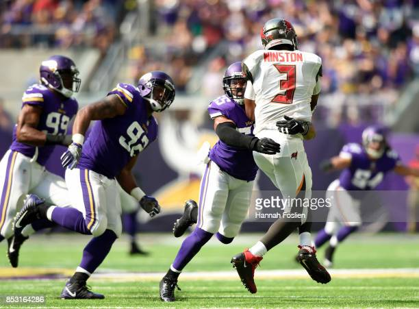 Jameis Winston of the Tampa Bay Buccaneers is hit by defender Anthony Barr of the Minnesota Vikings as he throws the ball in the first half of the...
