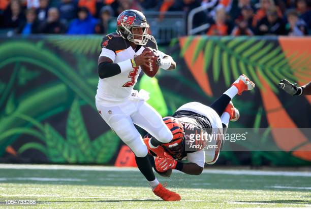 Jameis Winston of the Tampa Bay Buccaneers is sacked by Adolphus Washington of the Cincinnati Bengals at Paul Brown Stadium on October 28 2018 in...