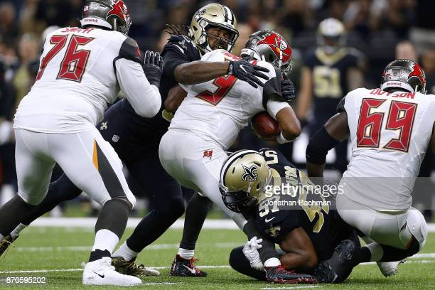 Jameis Winston of the Tampa Bay Buccaneers is sacked by Cameron Jordan of the New Orleans Saints and Alex Okafor during the first half of a game at...
