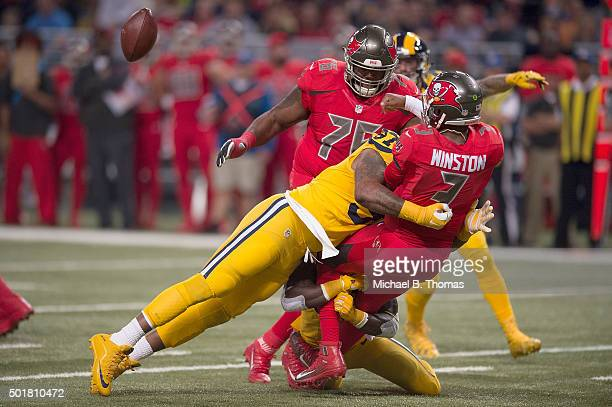Jameis Winston of the Tampa Bay Buccaneers is sacked by Eugene Sims of the St Louis Rams in the first quarter at the Edward Jones Dome on December 17...