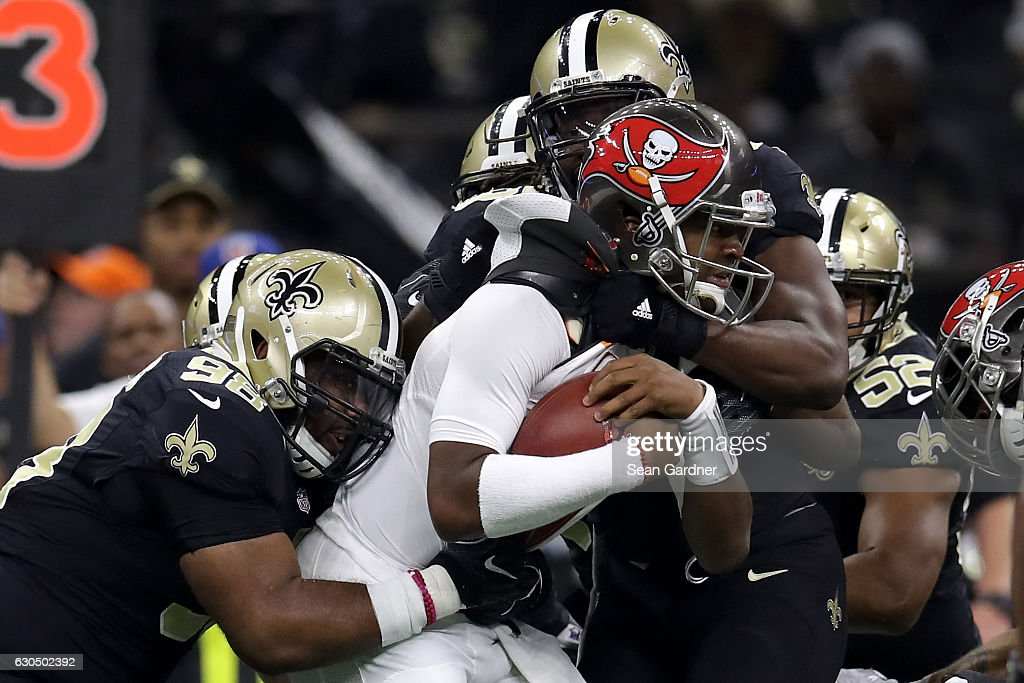 Jameis Winston #3 of the Tampa Bay Buccaneers is sacked by the New Orleans Saints at the Mercedes-Benz Superdome on December 24, 2016 in New Orleans, Louisiana.