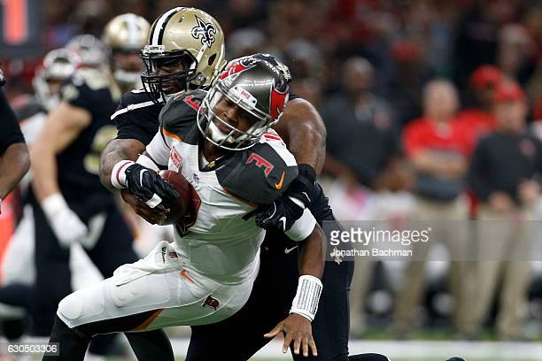 Jameis Winston of the Tampa Bay Buccaneers is tackled by Cameron Jordan of the New Orleans Saints at the MercedesBenz Superdome on December 24 2016...