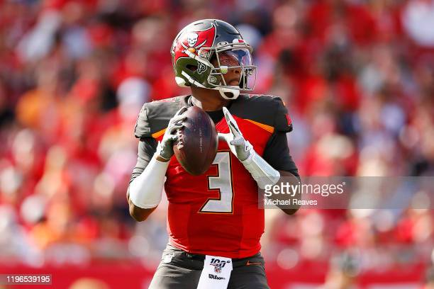 Jameis Winston of the Tampa Bay Buccaneers looks to pass against the Atlanta Falcons during the first half at Raymond James Stadium on December 29...