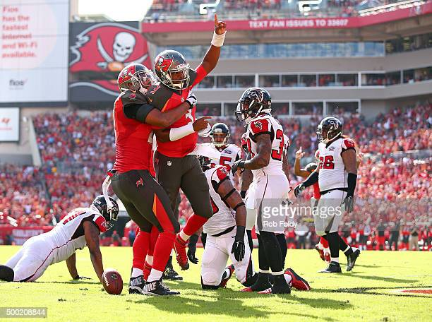 Jameis Winston of the Tampa Bay Buccaneers reacts after scoring a touchdown during the first quarter of the game against the Atlanta Falcons at...