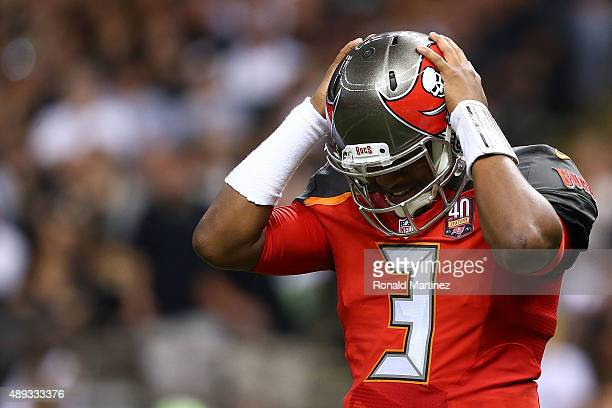 Jameis Winston of the Tampa Bay Buccaneers reacts to a play during the third quarter of a game against the New Orleans Saints at the MercedesBenz...