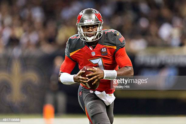 Jameis Winston of the Tampa Bay Buccaneers rolls out to pass during a game against the New Orleans Saints at MercedesBenz Superdome on September 20...