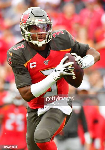 Jameis Winston of the Tampa Bay Buccaneers scrambles during the second quarter of a football game against the Houston Texans at Raymond James Stadium...