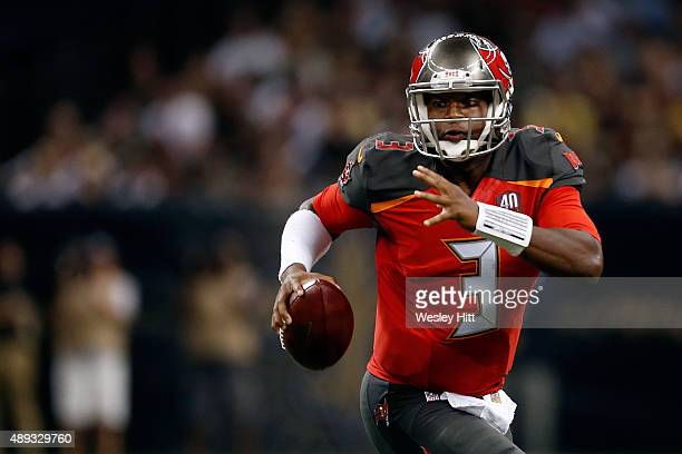 Jameis Winston of the Tampa Bay Buccaneers scrambles for yards during the second quarter of a game against the New Orleans Saints at the MercedesBenz...