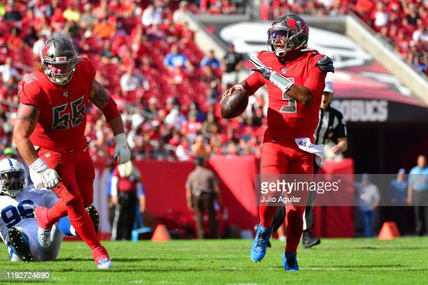 Jameis Winston of the Tampa Bay Buccaneers scrambles to throw a pass during the second quarter of a football game against the Indianapolis Colts at...