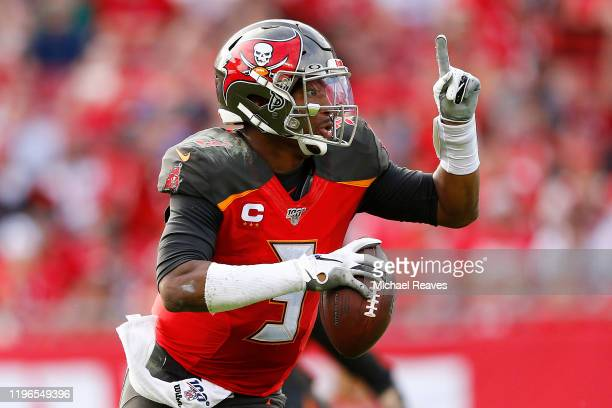 Jameis Winston of the Tampa Bay Buccaneers scrambles with the ball against the Atlanta Falcons during the second half at Raymond James Stadium on...