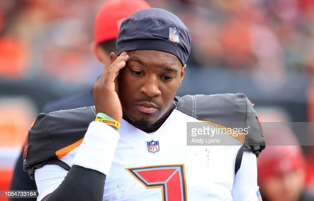 Jameis Winston of the Tampa Bay Buccaneers stands in the bench area after being replaced against the Cincinnati Bengals at Paul Brown Stadium on...