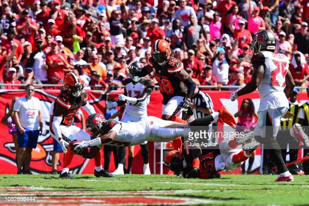 Jameis Winston of the Tampa Bay Buccaneers stretches out to score in the second quarter against the Cleveland Browns on October 21, 2018 at Raymond...