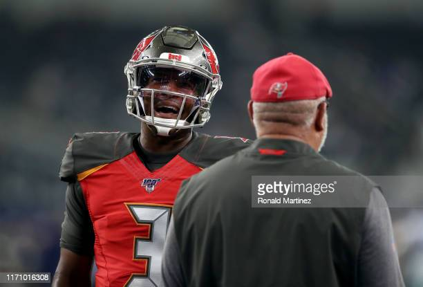 Jameis Winston of the Tampa Bay Buccaneers talks with head coach Bruce Arians of the Tampa Bay Buccaneers before a NFL preseason game at ATT Stadium...