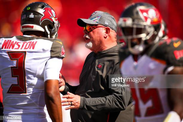Jameis Winston of the Tampa Bay Buccaneers talks with head coach Bruce Arians before the game agianst the Arizona Cardinals at Raymond James Stadium...