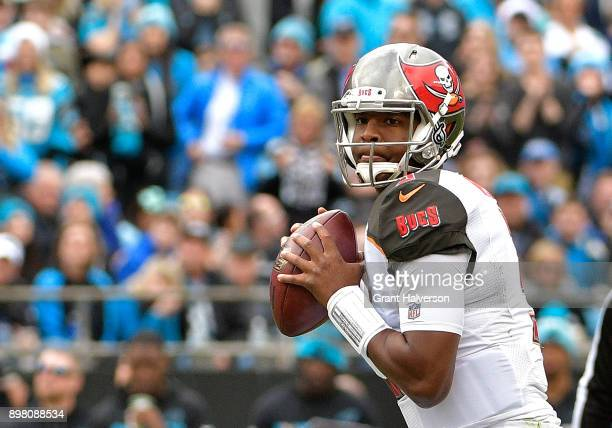 Jameis Winston of the Tampa Bay Buccaneers throws a pass against the Carolina Panthers in the first quarter at Bank of America Stadium on December 24...