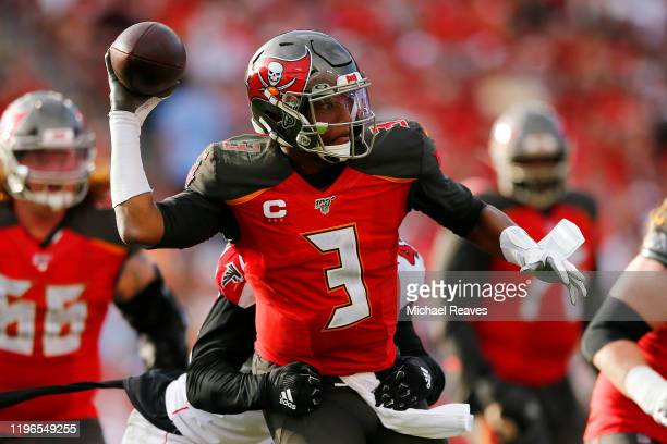 Jameis Winston of the Tampa Bay Buccaneers throws a pass under pressure against the Atlanta Falcons during the second half at Raymond James Stadium...