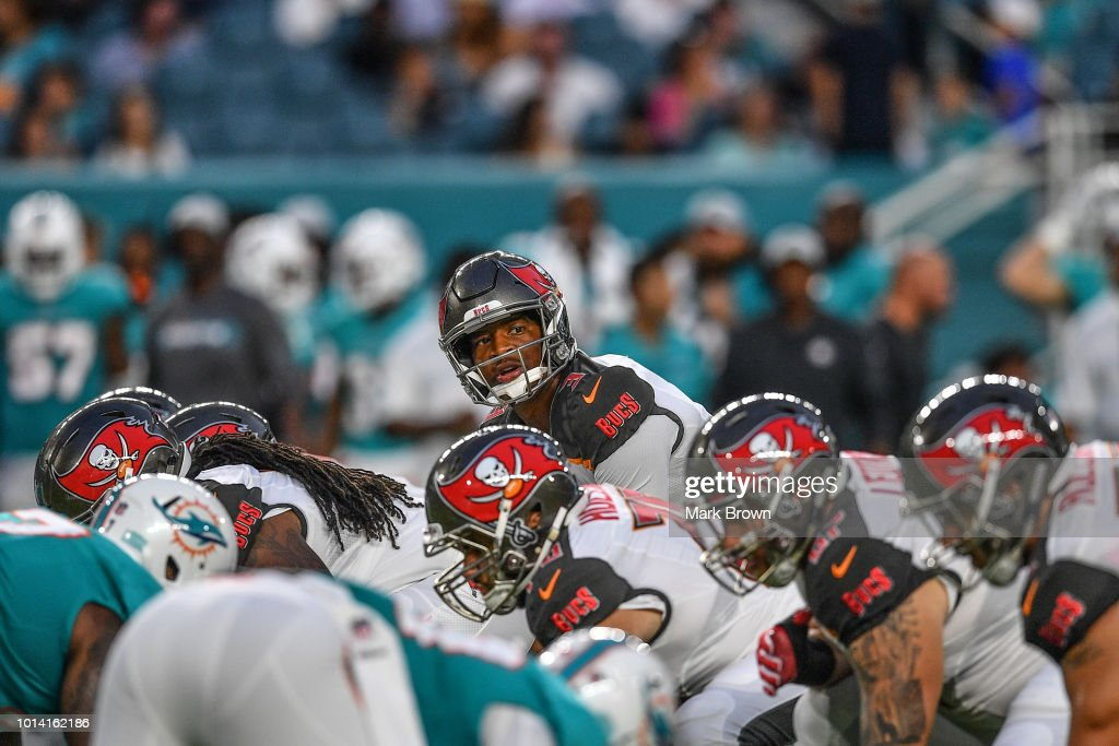 Jameis Winston #3 of the Tampa Bay Buccaneers under center in the second quarter during a preseason game against the Miami Dolphins at Hard Rock Stadium on August 9, 2018 in Miami, Florida.