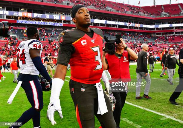 Jameis Winston of the Tampa Bay Buccaneers walks out on the field after a 2320 loss to the Houston Texans at Raymond James Stadium on December 21...