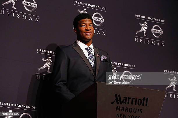 Jameis Winston quarterback of the Florida State Seminoles speaks to the media during a press conference after the 2013 Heisman Trophy Presentation at...