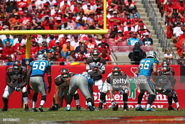 Jameis Winston waits for the snap from Joe Hawley of the Tampa Bay Buccaneers during the second quarter of the game against the Carolina Panthers at...