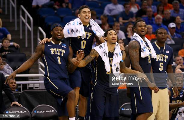 Jamel Artis, James Robinson, Cameron Wright, Michael Young and Durand Johnson of the Pittsburgh Panthers celebrate late in the second half while...