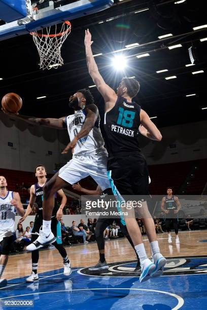 Jamel Artis of the Lakeland Magic shoots against Luke Petrasek of the Greensboro Swarm during the game on February 21 2018 at RP Funding Center in...