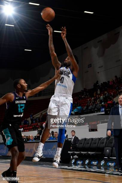 Jamel Artis of the Lakeland Magic shoots against Sam Thompson of the Greensboro Swarm during the game on February 21 2018 at RP Funding Center in...