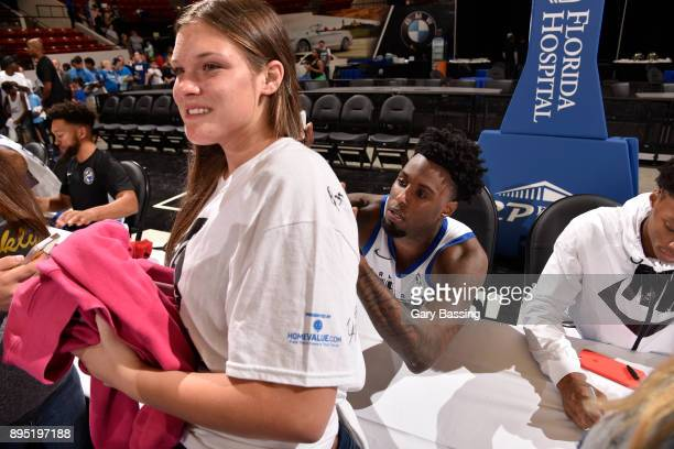 Jamel Artis of the Lakeland Magic signs autographs for fans after the game against the Canton Charge on November 10 2017 at RP Funding Center in...