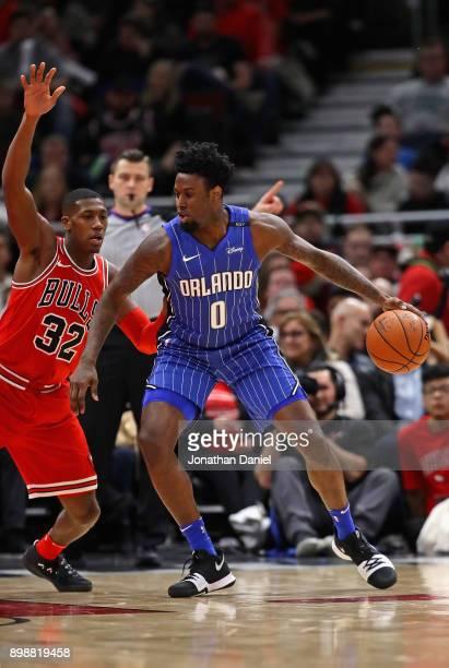 Jamel Artis of the Orlando Magic moves against Kris Dunn of the Chicago Bulls at the United Center on December 20 2017 in Chicago Illinois The Bulls...