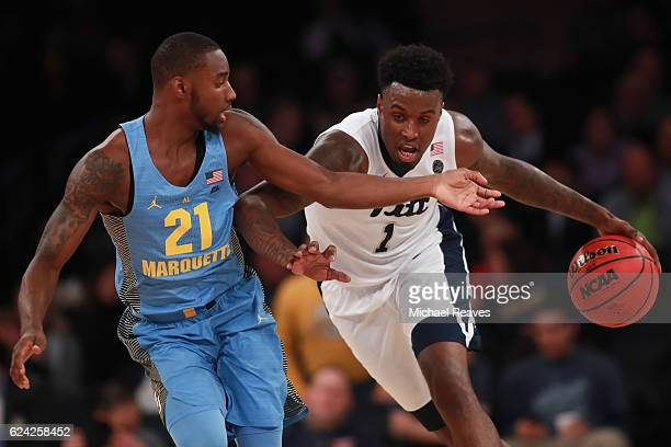 Jamel Artis of the Pittsburgh Panthers drives past Traci Carter of the Marquette Golden Eagles in the second half of the 2K Classic at Madison Square...