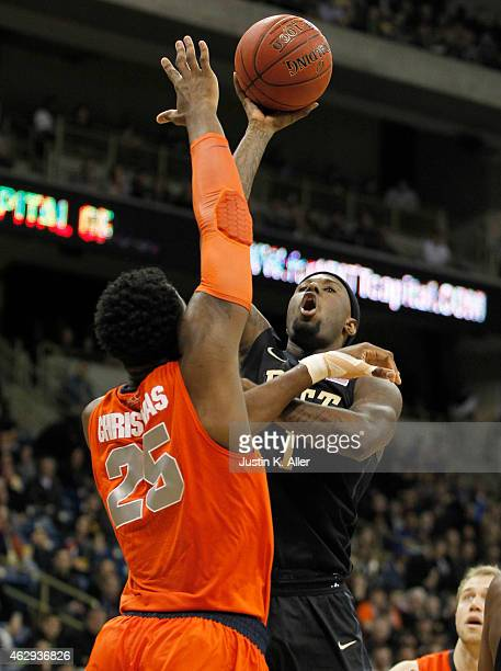 Jamel Artis of the Pittsburgh Panthers pulls up for a shot against Rakeem Christmas of the Syracuse Orange during the game at Petersen Events Center...