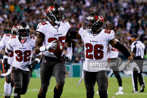 Jamel Dean Andrew Adams of the Tampa Bay Buccaneers celebrate an interception by Dean against the Philadelphia Eagles at Lincoln Financial Field on...