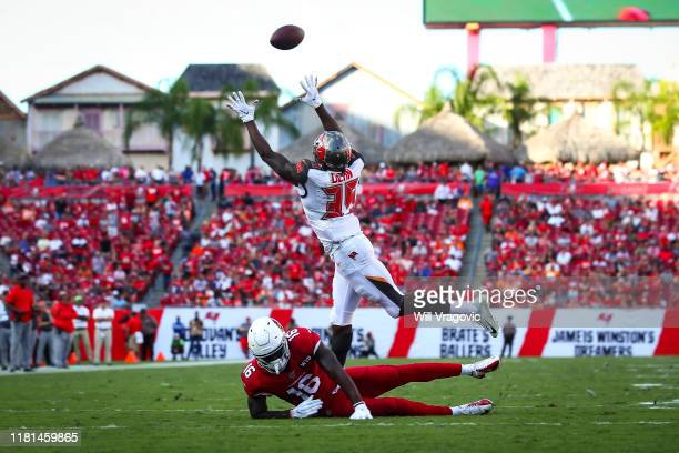 Jamel Dean of the Tampa Bay Buccaneers picks off a pass intended for Trent Sherfield of the Arizona Cardinals on November 10, 2019 at Raymond James...