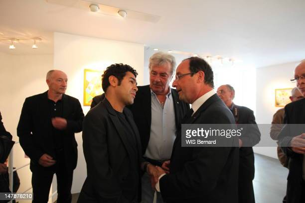Jamel Debbouze Alain Delon and French President Francois Hollande attend the opening of the exhibition of Florence Cassez the French citizen...