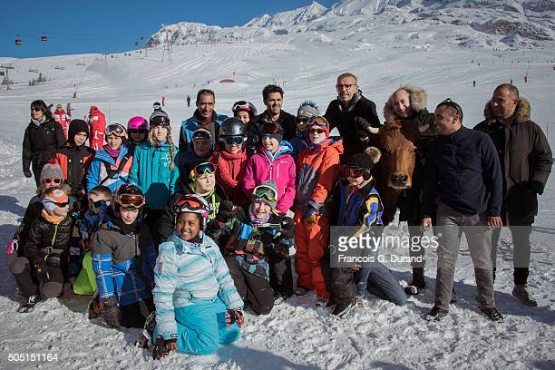 Jamel Debbouze poses with kids after the photocall for 'La Vache' during the 18th L'Alpe D'Huez International Comedy Film Festival on January 15 2016...