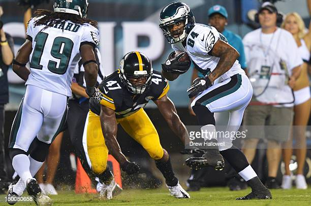 Jamel Hamler of the Philadelphia Eagles evades Myron Rolle of the Pittsburgh Steelers and runs for a touchdown at Lincoln Financial Field on August 9...