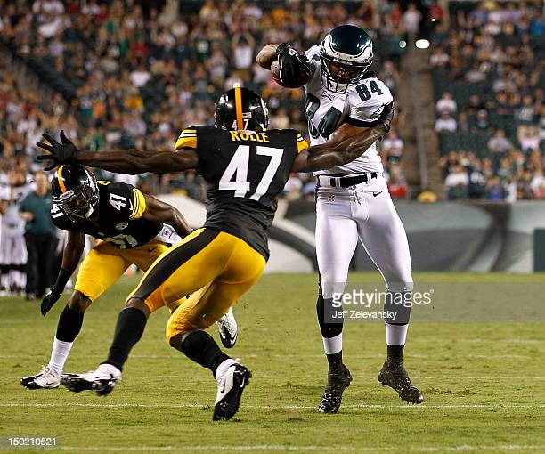Jamel Hamler of the Philadelphia Eagles runs by Myron Rolle of the Pittsburgh Steelers during a preseason game at Lincoln Financial Field on August 9...