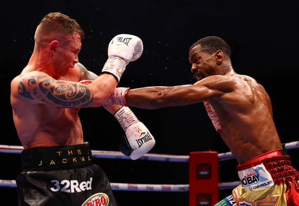 Jamel Herring of the USA and Carl Frampton of Northern Ireland exchange punches during the WBO World Super Featherweight Title Fight between Jamel...