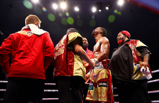 Jamel Herring of the USA celebrates victory with his corner after the WBO World Super Featherweight Title Fight between Jamel Herring and Carl...