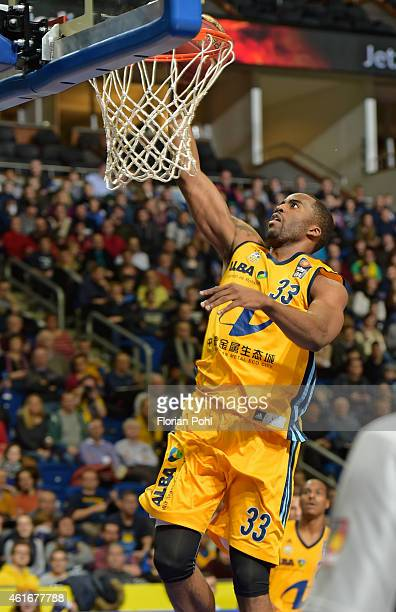 Jamel McLean of ALBA Berlin throws the ball during the game between Alba Berlin and Walter Tigers Tuebingen on january 17, 2015 in Berlin, Germany.