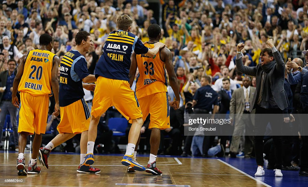 Jamel McLean (#33) of Berlin celebrates with team mates after scoring in the last second to win the NBA Global Games Tour 2014 match between Alba Berlin and San Antonio Spurs at O2 World on October 8, 2014 in Berlin, Germany.