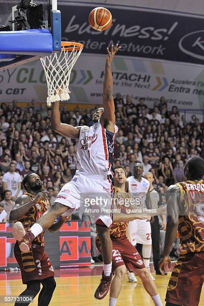 Jamel McLean of EA7 competes with Jeremy Pargo and Jeff Viggiano and Melvin Ejim of Umana during the LegaBsaket Serie A match between Reyer Umana...
