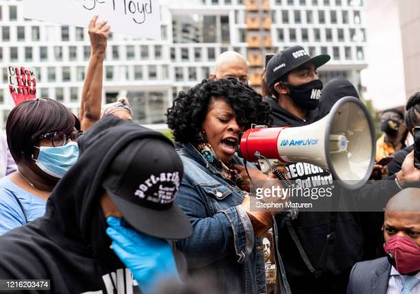 Jamela J Pettiford sings during a protest with Former NBA player Stephen Jackson in response to the police killing of George Floyd outside the...