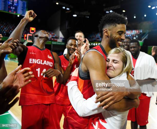 Jamell Anderson of England hugs his fiancee Georgia Jones after he proposed to her at the end of the Preliminary Basketball round match between...