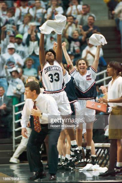 Jamelle Elliot and Missy Rose cheer on teammates during a game in Storrs CT 1995 Coach Geno Auriemma in the foreground