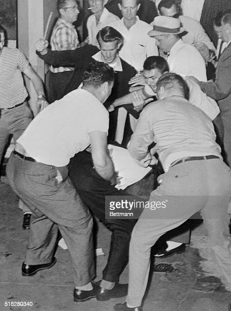 James A Peck of New York is mobbed at the Birmingham Bus station May 14th by whites opposing integration on the buses This was one of two incidents...